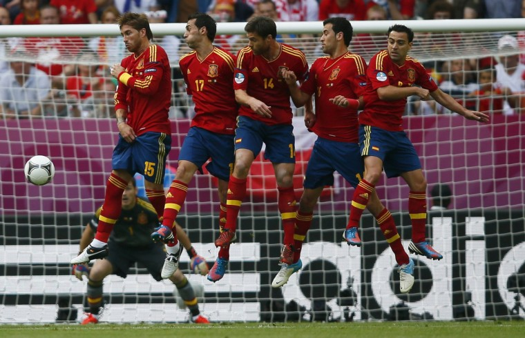 Spain's Sergio Ramos, Alvaro Arbeloa, Xabi Alonso, Sergio Busquets and Xavi Hernandez (L-R) form a defensive wall as Italy's Andrea Pirlo (not pictured) takes a free kick during their Group C Euro 2012 soccer match at the city stadium in Gdansk, June 10, 2012. (Kai Pfaffenbach/Reuters)