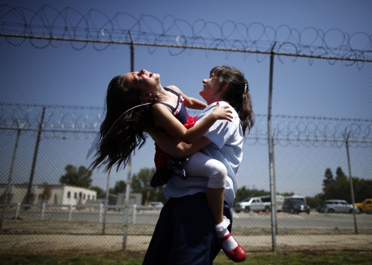 Cori Walters, 32, (R) hugs her daughter Hannah Walters, 6, at California Institute for Women state prison in Chino, California May 5, 2012. An annual Mother's Day event, Get On The Bus, brings children in California to visit their mothers in prison. Sixty percent of parents in state prison report being held over 100 miles (161 km) from their children. (Lucy Nicholson/Reuters)