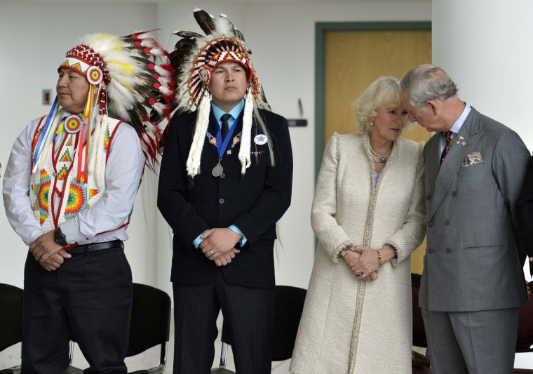Britain's Prince Charles (R) speaks with Camilla (2nd R), Duchess of Cornwall during an event at the First Nations University in Regina, Saskatchewan May 23, 2012. Prince Charles and his wife Camilla are on a three-day royal tour of Canada as part of events that mark the Queen's Diamond Jubilee. (Fred Greenslade/Reuters)