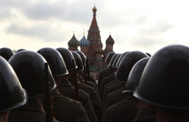 Russian servicemen, dressed in historical uniform, take part in a military parade rehearsal in Red Square, with St. Basil's Cathedral seen in the background, in Moscow November 5, 2012. The parade will be held on November 7 to mark the anniversary of a historical parade in 1941 when Soviet soldiers marched through Red Square towards the front lines at World War Two. (Sergei Karpukhin/Reuters)