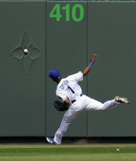 Kansas City Royals center fielder Jarrod Dyson can't reach a Cleveland Indians Jason Kipnis triple in the first inning during the Royals' home opener in their MLB American League baseball game in Kansas City, Missouri, April 13, 2012. (Dave Kaup/Reuters)