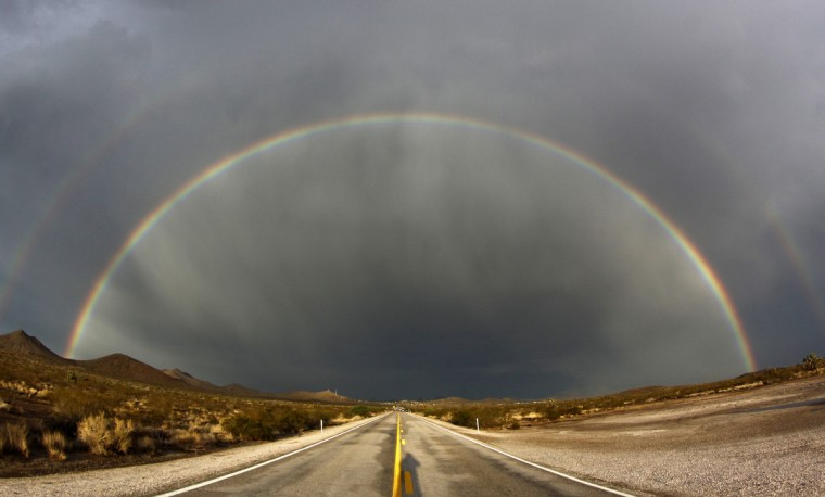 A double rainbow appears after a heavy monsoon storms over Nipton Road in Searchlight, Nevada, July 13, 2012. The National Weather Service has extended a flash flood watch through Saturday night, as rain and thunderstorms have rumbled into Southern Nevada. Picture taken July 13. 2012. (Gene Blevins/Reuters)