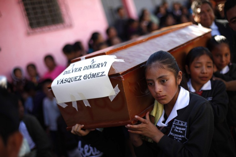 Children carry the coffin of Dilver Dinervi Vasquez Gomez on their way to the cemetery after ten members of the Vasquez Gomez family died from the earthquake that struck on Wednesday, in the cemetery of San Cristobal Cucho, about 250 km (155 miles) from Guatemala City, November 9, 2012. Rescue workers on Thursday carted out dead bodies found under rubble in the aftermath of Guatemala's most powerful earthquake in decades, while others cleared wrecked cars and collapsed buildings as they searched for survivors. (Jorge Dan Lopez/Reuters)