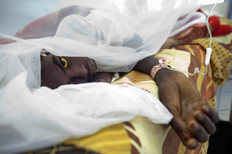 Saleh Mohammed Hamid, 18, from West Darfur's Gocker, is treated at Teaching Hospital after getting infected with yellow fever in El Geneina .According to UNAMID, the hospital, which has already treated 106 cases of yellow fever among of which 38 people have died, is expecting to receive thousands more vaccines. A yellow fever outbreak has killed nearly 100 people over the last seven weeks in Sudan's Darfur, the World Health Organization said, a region where fighting has undermined access to healthcare. The statement said 329 suspected yellow fever cases and 97 deaths had been reported since the last week of September. (Albert Gonzalez Farran/Reuters)