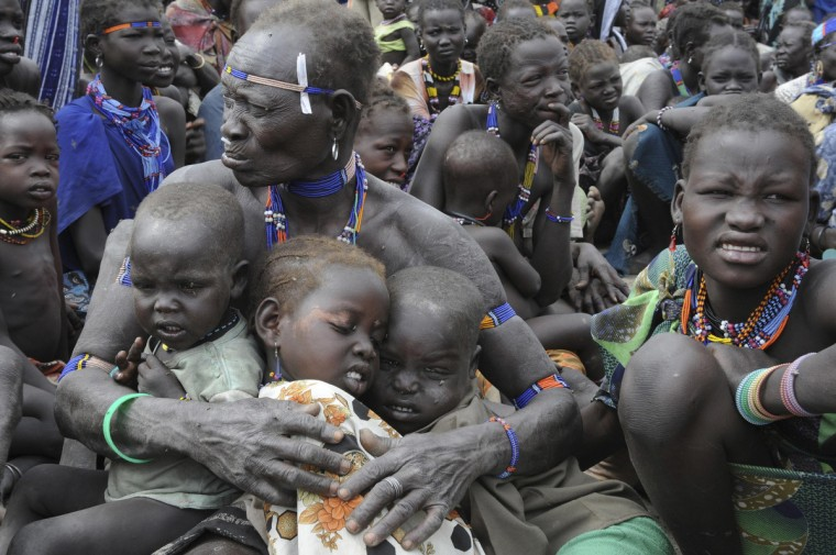 Internally displaced people are seen in Pibor January 12, 2012. The World Food Program (WFP) started distributing food to 60,000 internally displaced people in South Sudan, according to the United Nations Mission in South Sudan (UNMISS). (Isaac Billy/Reuters)