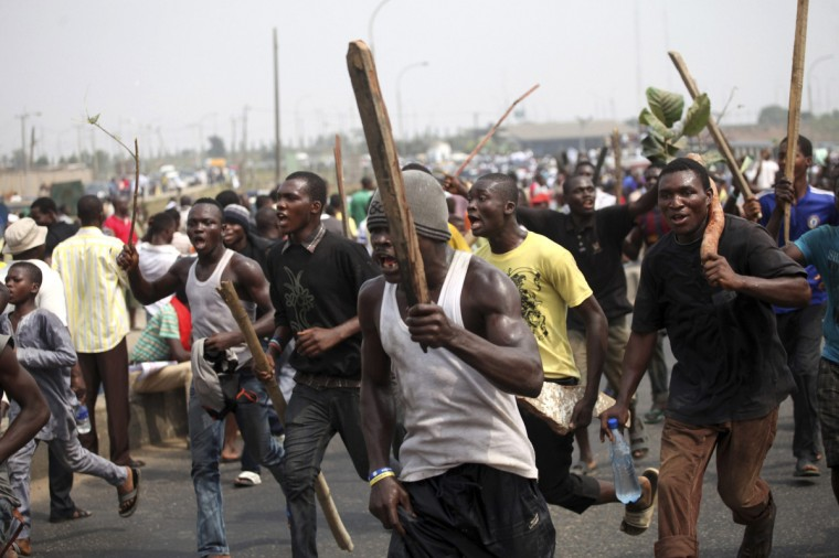 Protesters chant slogans as they march through Ikorodu road during a protest against a fuel subsidy removal in Lagos January 9, 2012. Thousands of Nigerians took to the streets across Africa's top oil producing nation on Monday, launching an indefinite nationwide strike to protest against the axing of fuel subsidies. (Akintunde Akinleye/Reuters)