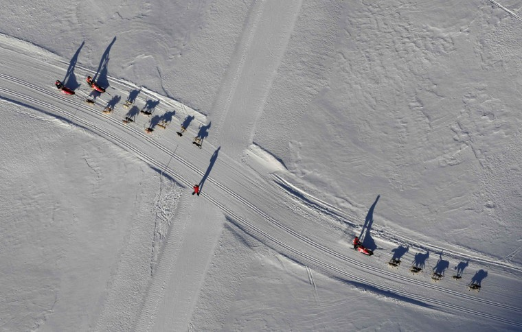 Mushers and their dogs compete after the mass start of the eighth stage of the La Grande Odyssee sled dogs race in Bessans January 16, 2012. The race crosses the Alps in France covering over 1000 km (621 miles) over 11 days. (Denis Balibouse/Reuters)