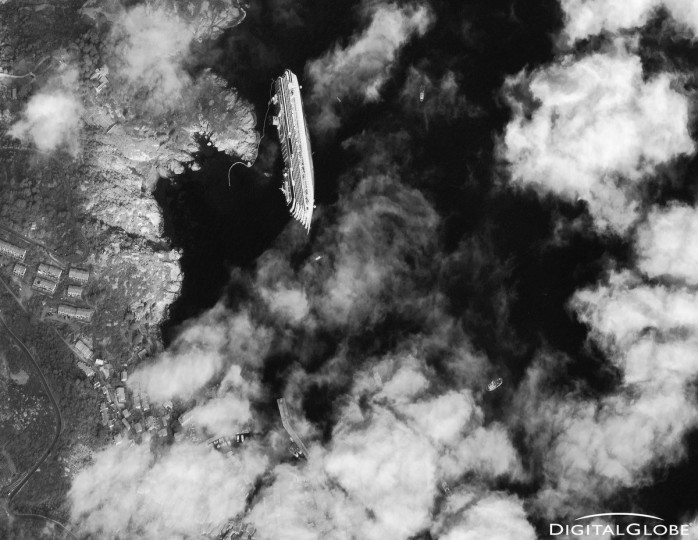 The luxury cruise ship Costa Concordia is shown run aground off the coast of Giglio in this January 17, 2012 DigitalGlobe handout satellite photo obtained by Reuters January 18, 2012. Eleven people are confirmed dead and at least 23 are still missing from more than 4,200 passengers and crew after the Concordia ran aground two hours into a week-long cruise of the western Mediterranean. (DigitalGlobe/Reuters)