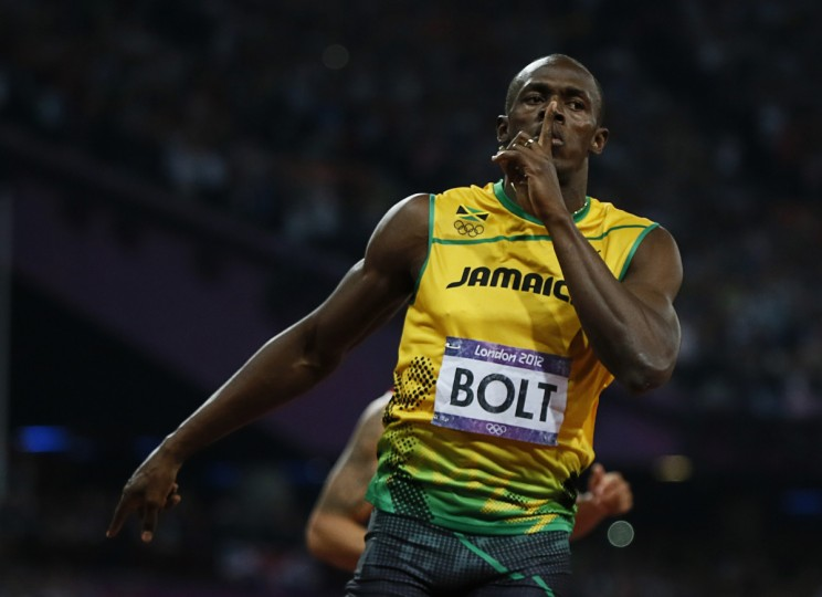 Jamaica's Usain Bolt celebrates winning the men's 200m final during the London 2012 Olympic Games at the Olympic Stadium August 9, 2012. (Lucy Nicholson/Reuters)