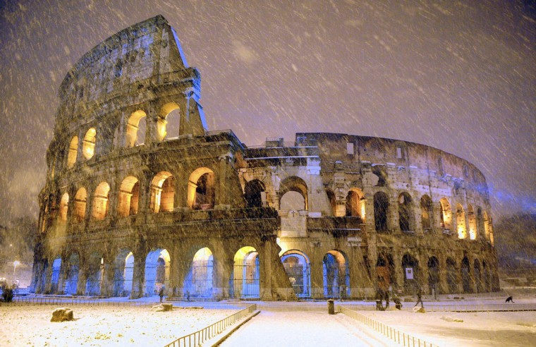 The ancient Colosseum is seen during an heavy snowfall late in the night in Rome February 4, 2012. (Gabriele Forzano/Reuters)
