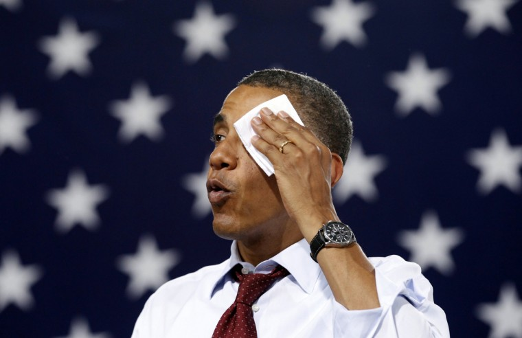 U.S. President Barack Obama wipes perspiration from his face as he speaks in a sweltering gym during a campaign stop at Windham High School in Windham, New Hampshire, August 18, 2012. (Kevin Lamarque/Reuters)
