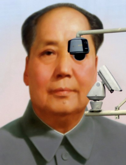 Security cameras are seen in front of the giant portrait of former Chinese Chairman Mao Zedong at Tiananmen Square in Beijing, August 28, 2012. (Petar Kujundzic/Reuters)