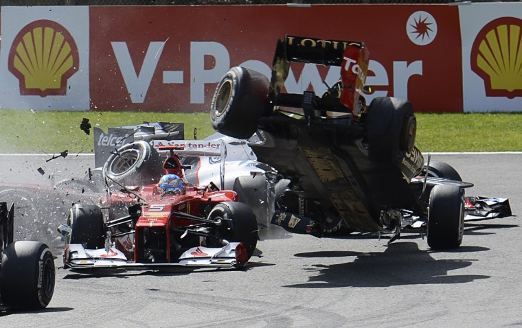 Lotus Formula One driver Romain Grosjean (R) of France crashes with Ferrari Formula One driver Fernando Alonso (L) of Spain at the start of the Belgian Grand Prix in Spa Francorchamps September 2, 2012. (Jan Van De Vel/Reuters)