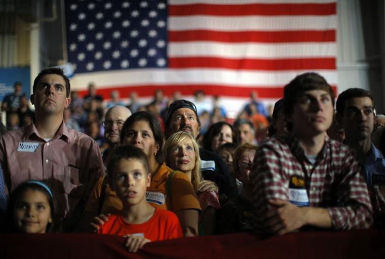 Audience members listen as Republican presidential nominee Mitt Romney speaks at a campaign rally in Cedar Rapids, Iowa October 24, 2012. (Brian Snyder/Reuters)