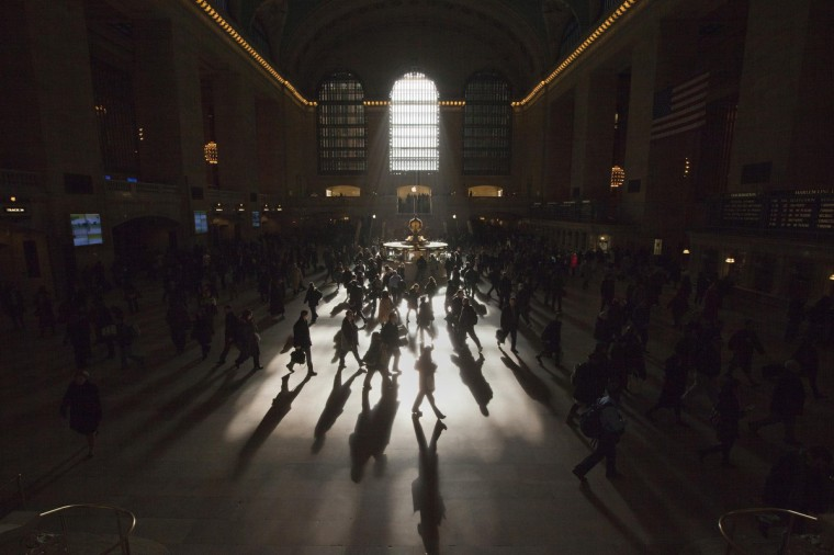 Morning commuters are silhouetted as they walk through the main concourse of the Grand Central Terminal, also known as Grand Central Station, in New York March 5, 2012. (Adrees Latif/Reuters)