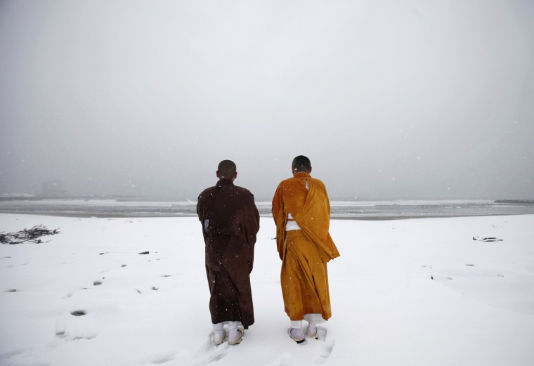Buddhist monks offer prayers for victims of the March 11, 2011 earthquake and tsunami at Kitaizumi beach in Minamisoma, Fukushima prefecture, some 25 km (15 miles) from the tsunami-crippled Fukushima Daiichi nuclear power plant March 10, 2012, a day before the disaster's one-year anniversary. The magnitude 9.0 earthquake on March 11 last year unleashed a tsunami that killed about 16,000 and triggered the world's worst nuclear crisis since Chernobyl. About 326,000 people are still homeless and nearly 3,300 remain unaccounted for. (Yuriko Nakao/Reuters)