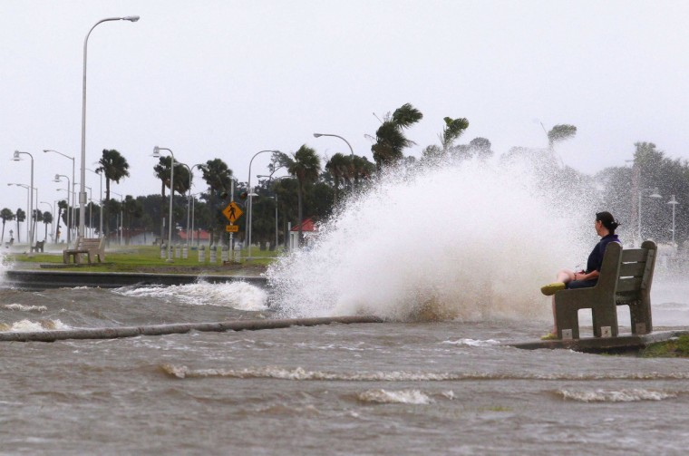 New Orleans resident Diana Whipple watches waves crash on the shore of Lake Pontchatrain as Tropical Storm Isaac approaches New Orleans, Louisiana, August 28, 2012. Tropical Storm Isaac was near hurricane force as it bore down on the U.S. Gulf Coast on Tuesday and was expected to make landfall in the New Orleans area seven years after it was devastated by Hurricane Katrina. (Jonathan Bachman/Reuters)