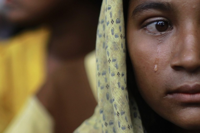 A Muslim woman, displaced by recent violence in Kyukphyu township, cries after arriving at the Thaechaung refugee camp outside of Sittwe October 28, 2012. (Soe Zeya Tun/Reuters)