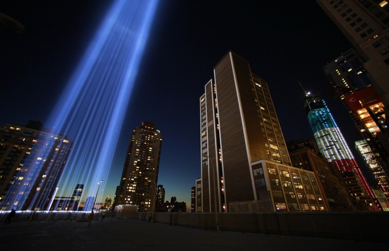 The Tribute in Light illuminates the sky over Lower Manhattan in remembrance of the 9/11 attacks on the 11-year anniversary as One World Trade is seen lit up in red, white and blue in New York September 11, 2012. (Eric Thayer/Reuters)