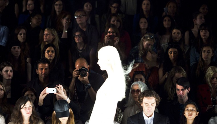 Audience members watch a model during the J. Mendel Spring/Summer 2013 show at New York Fashion Week, September 12, 2012. (Andrew Burton/Reuters)