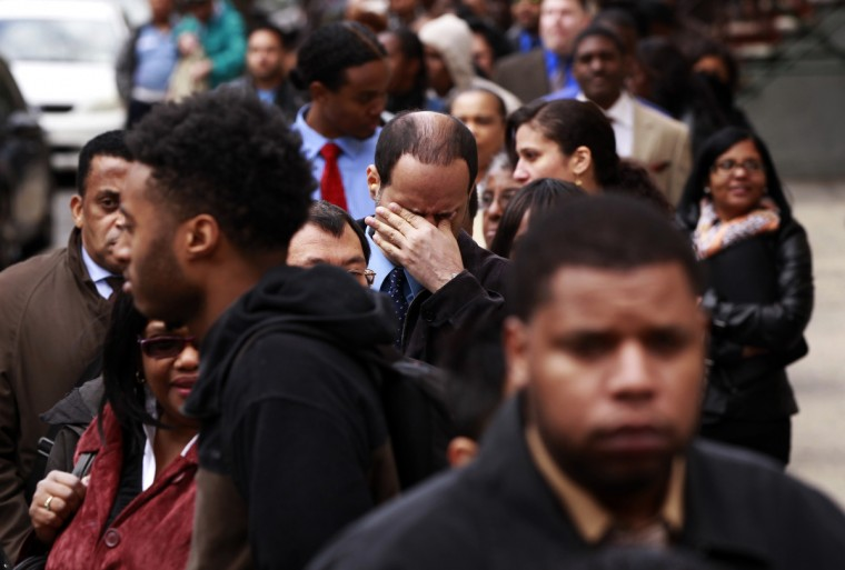 A man rubs his eyes as he waits in a line of jobseekers, to attend the Dr. Martin Luther King Jr. career fair held by the New York State department of Labor in New York April 12, 2012. A report on Friday showed the economy created only 120,000 jobs last month, the fewest since October. The unemployment rate fell to a three-year low of 8.2 percent, but largely as people gave up the search for work. (Lucas Jackson/Reuters)