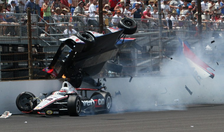 Team Penske driver Will Power of Australia, bottom, goes under the car of A.J. Foyt Enterprises driver Mike Conway of Britain during the Indianapolis 500 auto race at the Indianapolis Motor Speedway in Indianapolis, Indiana, May 27, 2012. (Peter Kirles/Reuters)