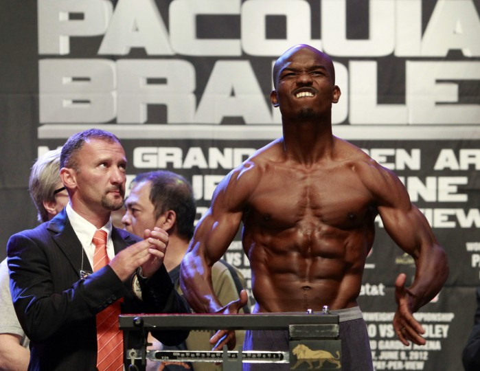 U.S. boxer Timothy Bradley Jr. shows off his physique during an official weigh-in before his bout with Filipino boxer Manny Pacquiao at the MGM Grand Garden Arena in Las Vegas, Nevada June 8, 2012. Pacquiao will defend his WBO welterweight title against the undefeated Bradley at the arena on June 9. (Steve Marcus/Reuters)