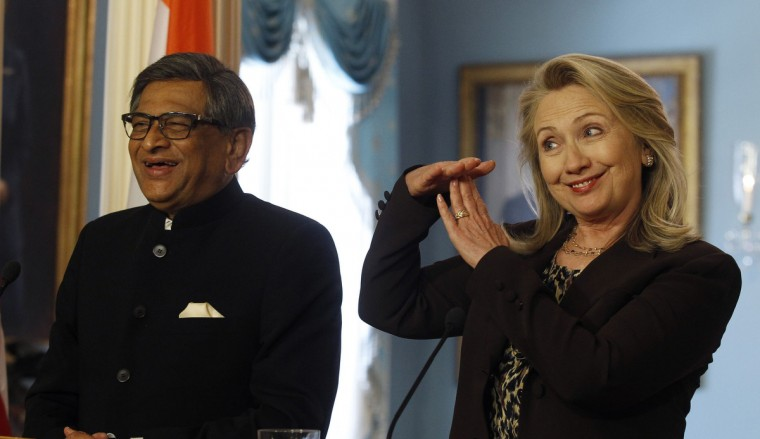 U.S. Secretary of State Hillary Clinton (R) calls a time-out during a multiple question from an Indian journalist, as India's Foreign Minister S.M. Krishna smiles during their news conference at the U.S.-India Strategic Dialogue in Washington June 13, 2012. (Gary Cameron/Reuters)