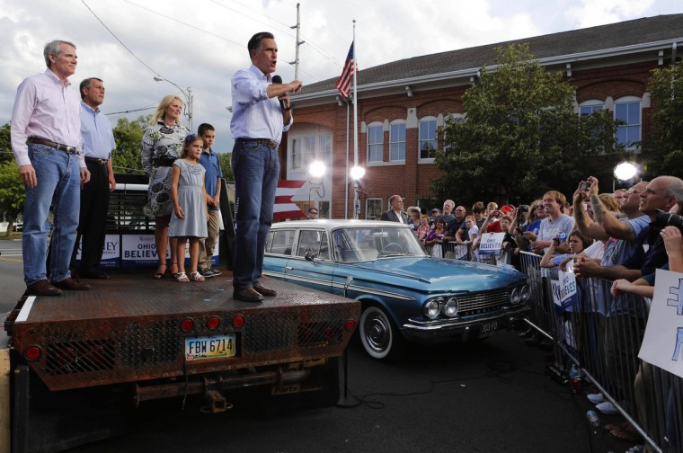U.S. Republican presidential candidate Mitt Romney speaks outside K's Hamburger Shop while standing on a flatbed truck parked next to a 1961 Rambler classic car in Troy, Ohio, June 17, 2012. Romney had been on a campaign bus tour since Friday for a five-day road trip through six battleground states. Joining him are (L-R): Senator Rob Portman (R-OH), Speaker of the House John Boehner and Romney's wife, Ann. (Larry Downing/Reuters)