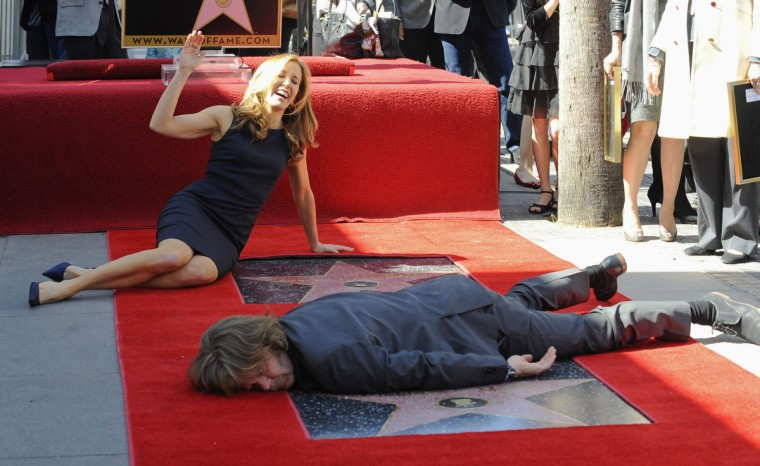Actors Felicity Huffman and her husband William H. Macy pose for photographers at the Hollywood Walk of Fame March 7, 2012. Huffman and Macy have been awarded joint stars on the Hollywood Walk of Fame by the Hollywood Chamber of Commerce in Los Angeles. (Gus Ruelas/Reuters)