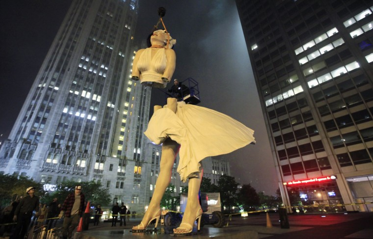 """A 26-foot tall statue of Marilyn Monroe is separated for disassembly in Chicago, May 7, 2012. The sculpture """"Forever Marilyn"""" by artist Seward Johnson, is based on a scene from the movie """"Seven Year Itch"""" was taken down after being on display since last July. (Jim Young/Reuters)"""