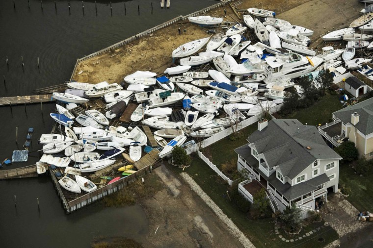 Boats are seen in a yard, where they washed onto shore during Hurricane Sandy, near Monmouth Beach, New Jersey October 31, 2012. The U.S. Northeast began an arduous slog back to normal on Wednesday after historic storm Sandy crippled transportation, knocked out power for millions and killed at least 64 people with a massive storm surge that caused epic flooding. (Steve Nesius/Reuters)