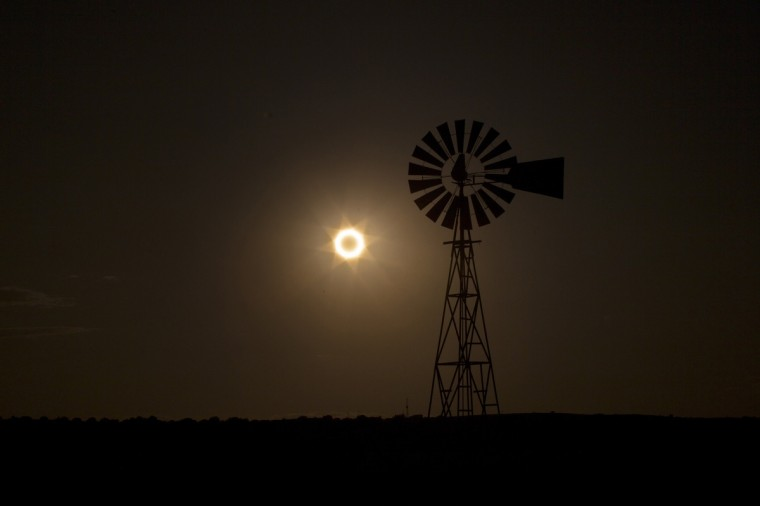 The moon passes between the sun and the earth behind a windmill near Albuquerque, New Mexico May 20, 2012. The sun and moon aligned over the earth in a rare astronomical event - an annular eclipse that dimmed the skies over parts of Asia and North America, briefly turning the sun into a blazing ring of fire. (Lucas Jackson/Reuters)