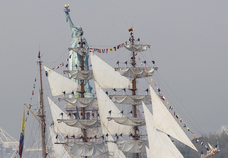 Sailors line the mast of the tall ship ARC Gloria, training ship and official flagship of the Colombian Navy, as it passes the Statue of Liberty in New York Harbor while arriving for the 25th annual Fleet Week celebration in New York, May 23, 2012. (Brendan McDermid/Reuters)
