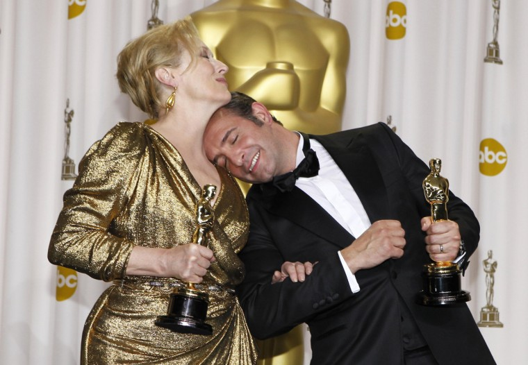 "Meryl Streep, Best Actress winner for ""The Iron Lady,"" and French actor Jean Dujardin, Best Actor winner for ""The Artist,"" pose backstage at the 84th Academy Awards in Hollywood, California, February 26, 2012. (Mike Blake/Reuters)"