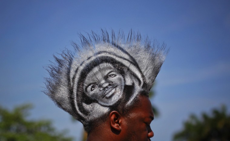 A man, who identified himself as Mohawk Gaz, sports an image of black teenager Trayvon Martin on his hair during a rally to protest his killing in Miami, Florida April 1, 2012. Thousands of protesters gathered in a downtown bayfront park on Sunday demanding the arrest of the neighborhood watch volunteer who shot and killed an unarmed black teenager, Trayvon Martin, in central Florida a month ago. (Lucas Jackson/Reuters)