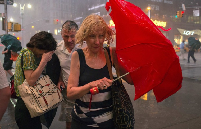Commuters dodge high wind and heavy rain during a thunderstorm in midtown Manhattan, in New York July 18, 2012. (Adrees Latif/Reuters)