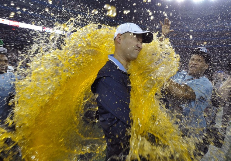 Toronto Argonauts head coach Scott Milanovich is doused by his players after the Argonauts defeated the Calgary Stampeders in the 100th CFL Grey Cup championship football game in Toronto, November 25, 2012. (Mike Cassese/Reuters)