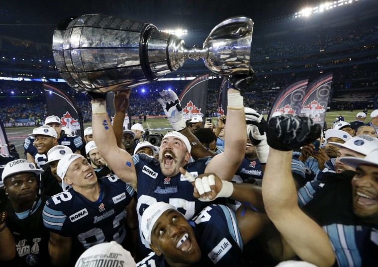 Toronto Argonauts Jeff Keeping celebrates with the Grey Cup after the Argonauts defeated the Calgary Stampders in the 100th CFL Grey Cup championship football game in Toronto, November 25, 2012. (Mark Blinch/Reuters)