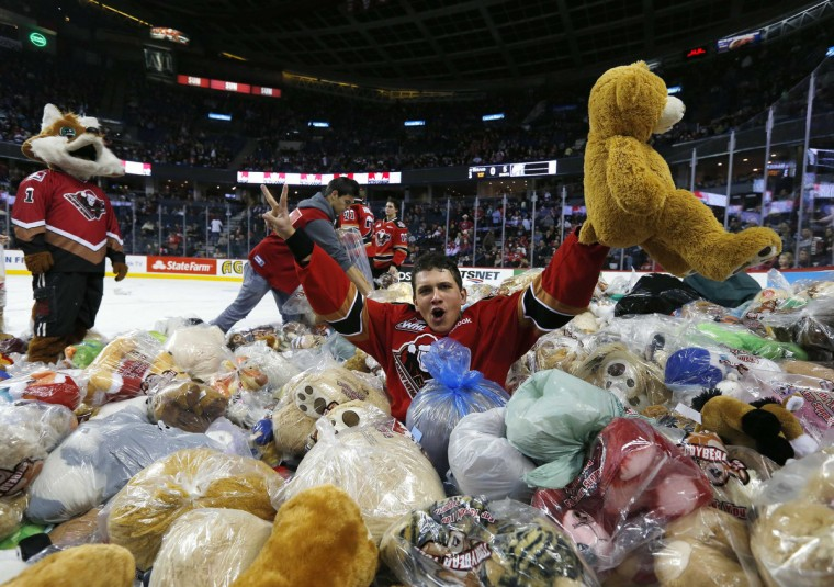Calgary Hitmen Pavlo Padakin celebrates his goal in a pile of Teddy Bears at the Hitmen Teddy Bear toss during their major junior hockey game against the Kootenay Ice in Calgary, Alberta, December 2, 2012. The hockey team collects approximately 25,000 stuffed toys at the annual Teddy Bear toss and then delivers the toys to local charities and children at the Alberta Children's Hospital. The team currently holds the world record for collecting the most Teddy Bears at 26,919. (Todd Korol/Reuters)
