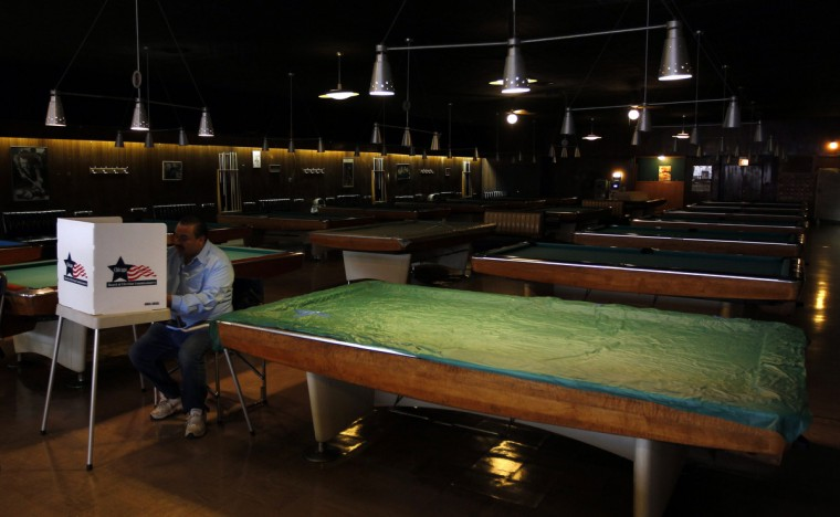 A voter casts his vote at Marie's Golden Cue pool hall during the U.S. presidential election in Chicago, Illinois, November 6, 2012. (Jeff Haynes/Reuters)