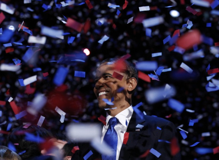 U.S. President Barack Obama celebrates on stage as confetti falls after his victory speech during his election rally in Chicago, November 6, 2012. (Kevin Lamarque/Reuters)