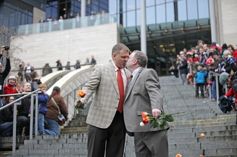 Brad and Jay McCanta kiss to a cheering crowd on the steps of City Hall after getting married at Seattle City Hall in Seattle, Washington December 9, 2012. Washington made history last month as one of three U.S. states where marriage rights were extended to same-sex couples by popular vote, joining Maryland and Maine in passing ballot initiatives recognizing gay nuptials. (Cliff Despeaux/Reuters)
