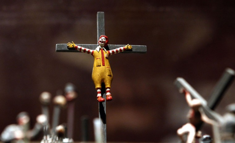 A figure of a crucified Ronald McDonald, mascot of the McDonald fast-food restaurant chain, is seen as part of the display by British artists Jake and Dinos Chapman entitled 'The End of Fun' in the Hermitage Museum in St.Petersburg. Prosecutors acted after receiving complaints from visitors who said the exhibition by the British artists offended the feelings of Russian Orthodox Christians. (Alexander Demianchuk/Reuters)