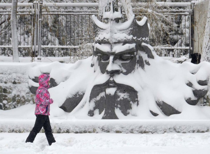 A pedestrian walks past a monument covered with snow in Russia's far eastern city of Vladivostok December 4, 2012. (Yuri Maltsev/Reuters)