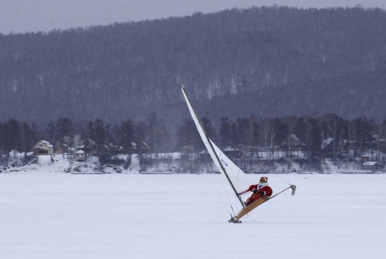 Valery Shevchenko, 40, dressed as Santa Claus, ice sails on the frozen Bolshoye lake near the village of Parnaya, about 211 milessouthwest of Russia's Siberian city of Krasnoyarsk, December 2, 2012. (Ilya Naymushin/Reuters)