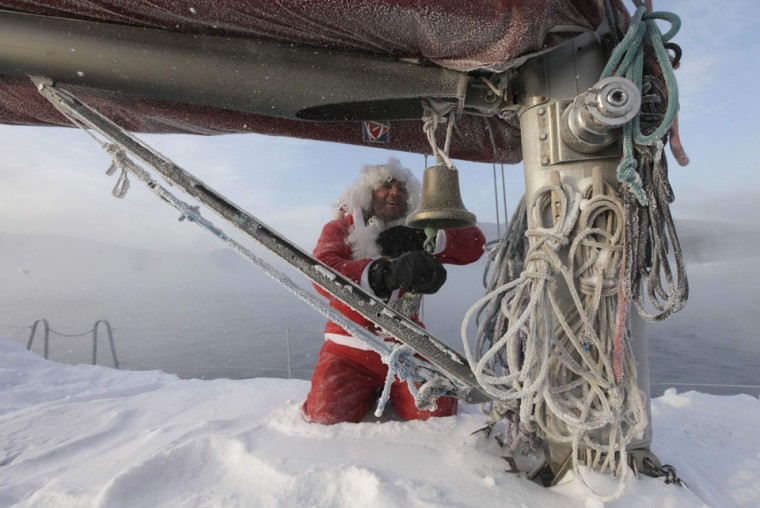 Valery Kokoulin, 47, dressed as Santa Claus, rings a bell on his self-made yacht to mark the ending of the sailboat season, as the air temperature dropped to minus 23 degrees of Celsius (minus 9.4 degrees Fahrenheit), on the Yenisei River, outside Russia's Siberian city of Krasnoyarsk. (Ilya Naymushin/Reuters)