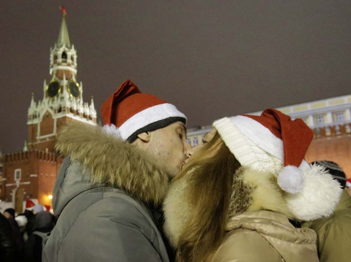 Revellers kiss as they celebrate ahead of New Year's Day in Red Square in Moscow December 31, 2012. (Tatyana Makeyeva/Reuters)