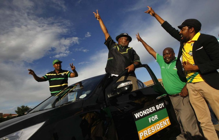 Supporters of President Jacob Zuma celebrate as delegates to the National Conference of the ruling African National Congress (ANC) begin voting for their leadership in Bloemfontein, December 17, 2012. Zuma is being challenged by his deputy Kgalema Motlanthe for the position of President of the party which has ruled South Africa since the country's first democratic elections in 1994. (Mike Hutchings/Reuters)
