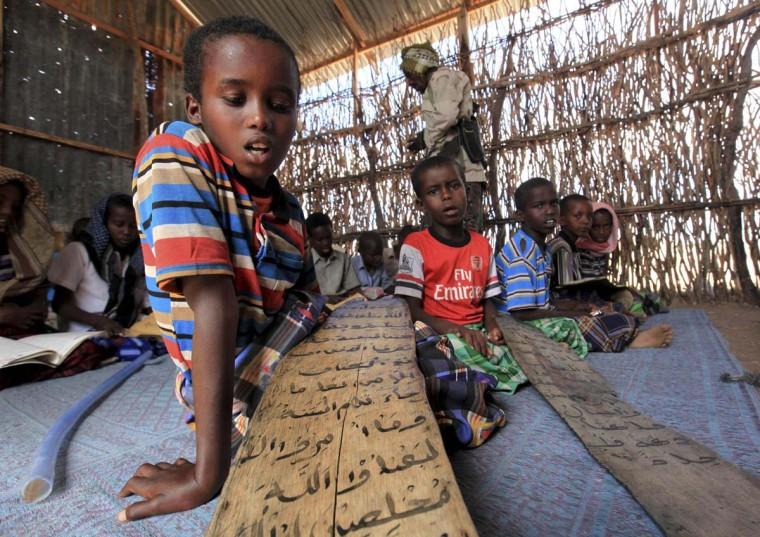 Students read Koranic verses at a madrasa, or Koranic school, in Dhusamareeb, central Somalia, December 16, 2012. (Feisal Omar/Reuters)